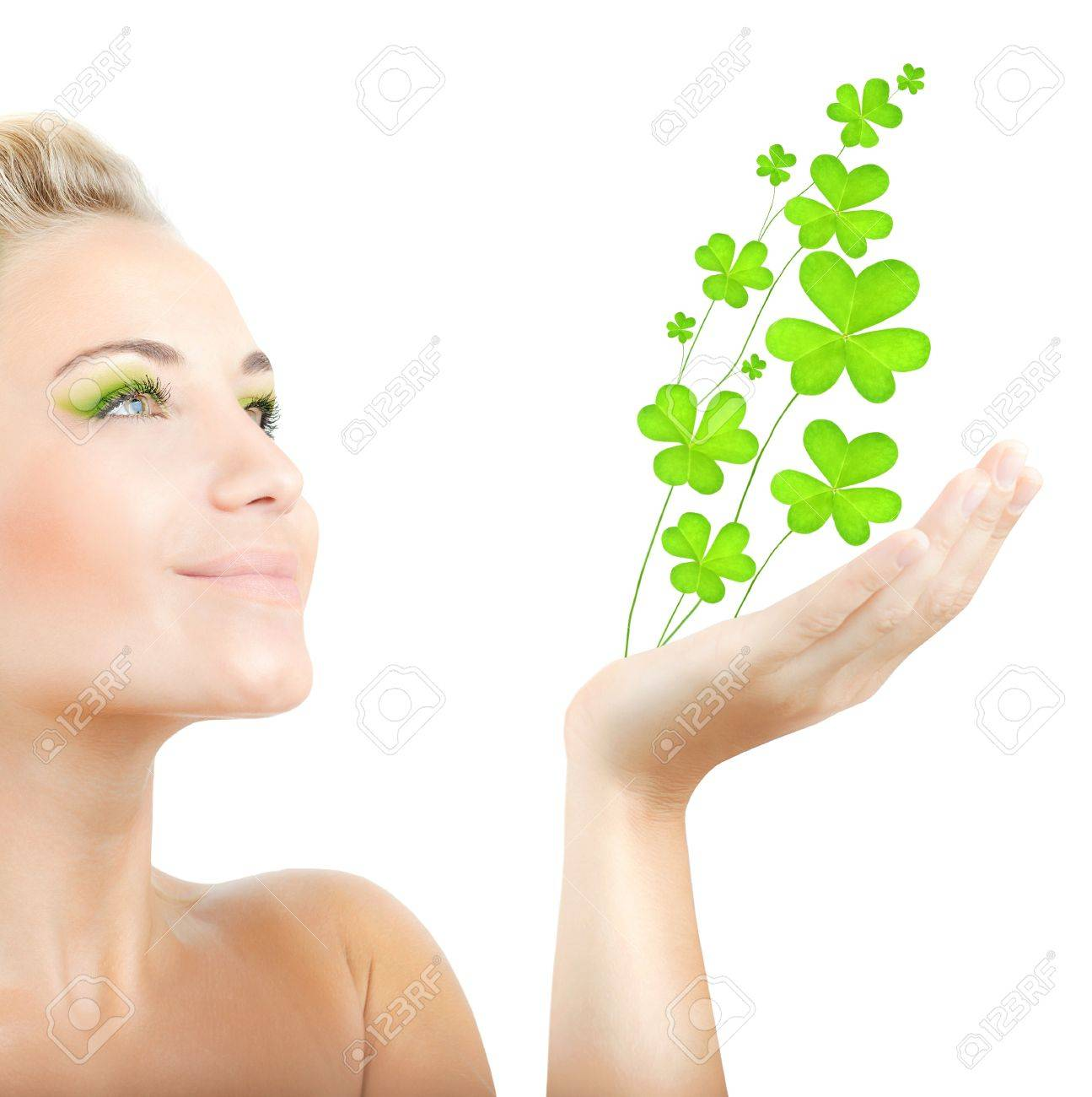 Beautiful woman holding fresh clover plant  in hand, sensual female portrait isolated on white background, cute girl with bright green makeup, st.Patrick's day holiday Stock Photo - 12589152