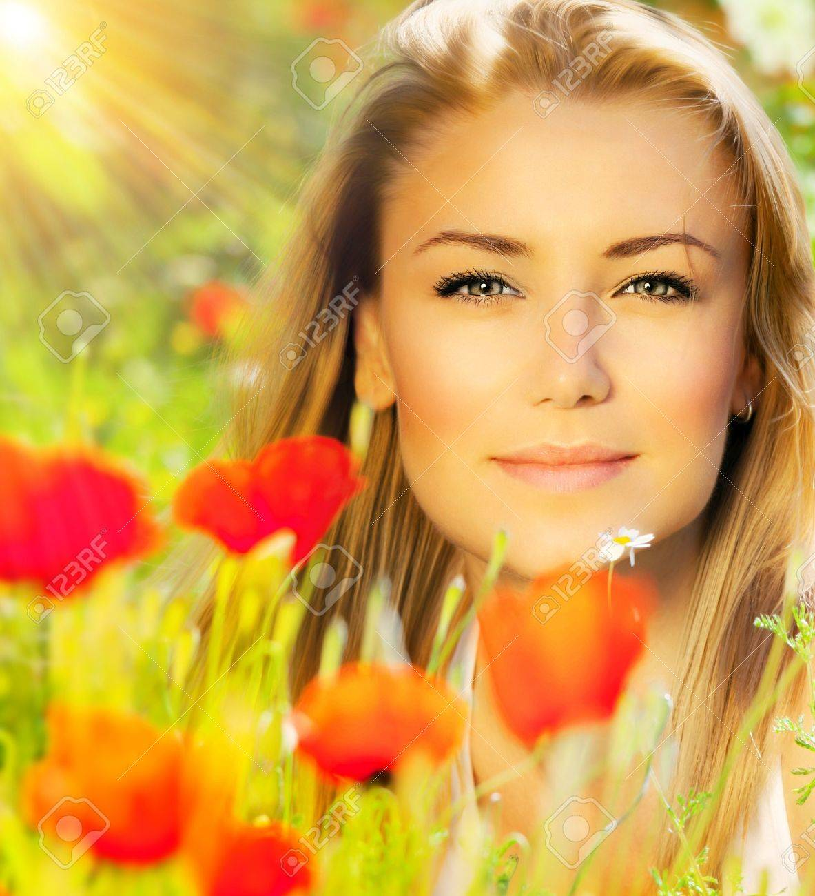 Closeup on beautiful woman face, female enjoying flower field, lovely girl at spring outdoor vacation, nice model relaxing at floral poppy garden, gorgeous model over natural bakground at sunny day Stock Photo - 12880164