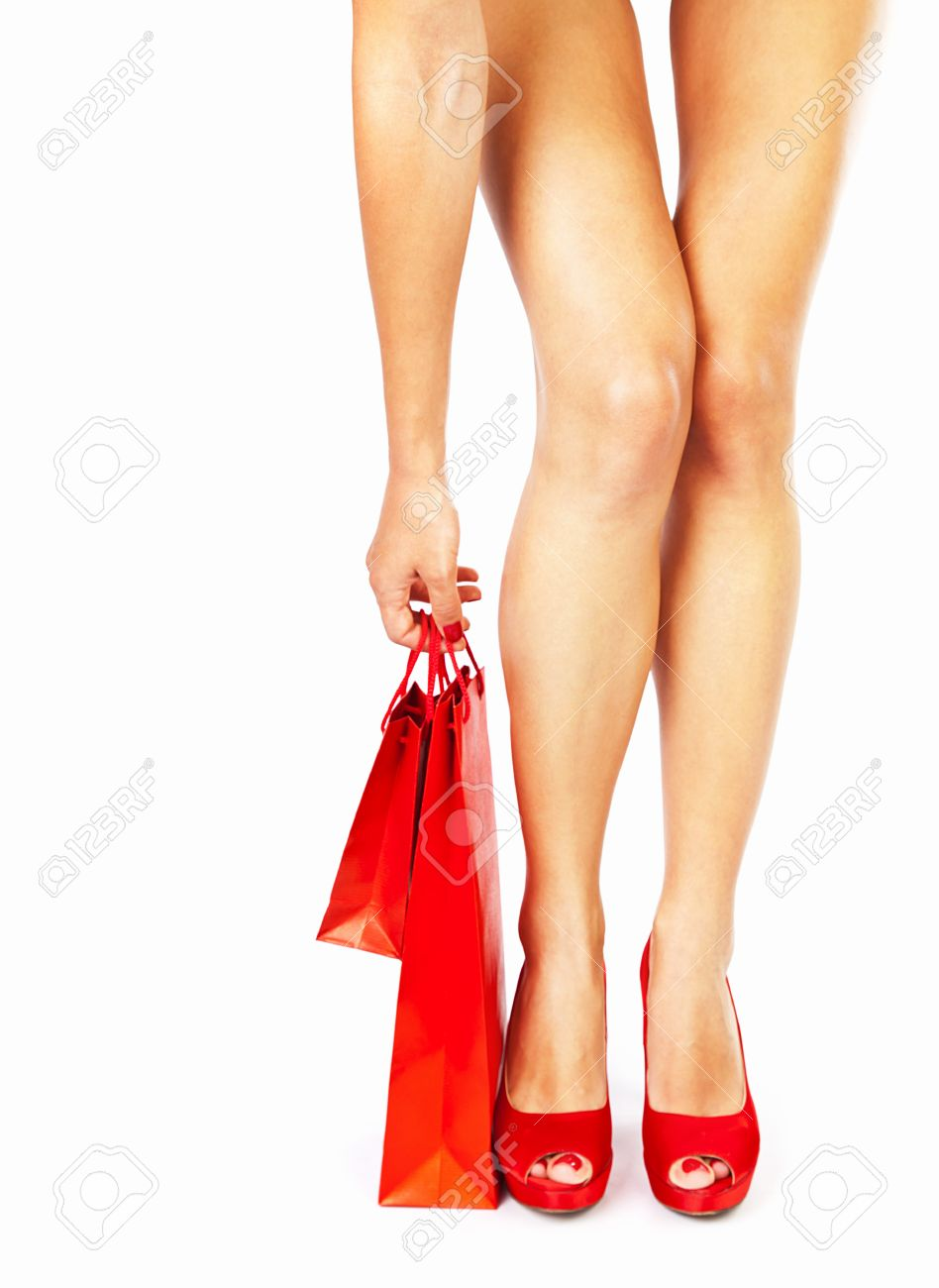 Beautiful Female Legs With Red High Heels Holding Shopping Bags