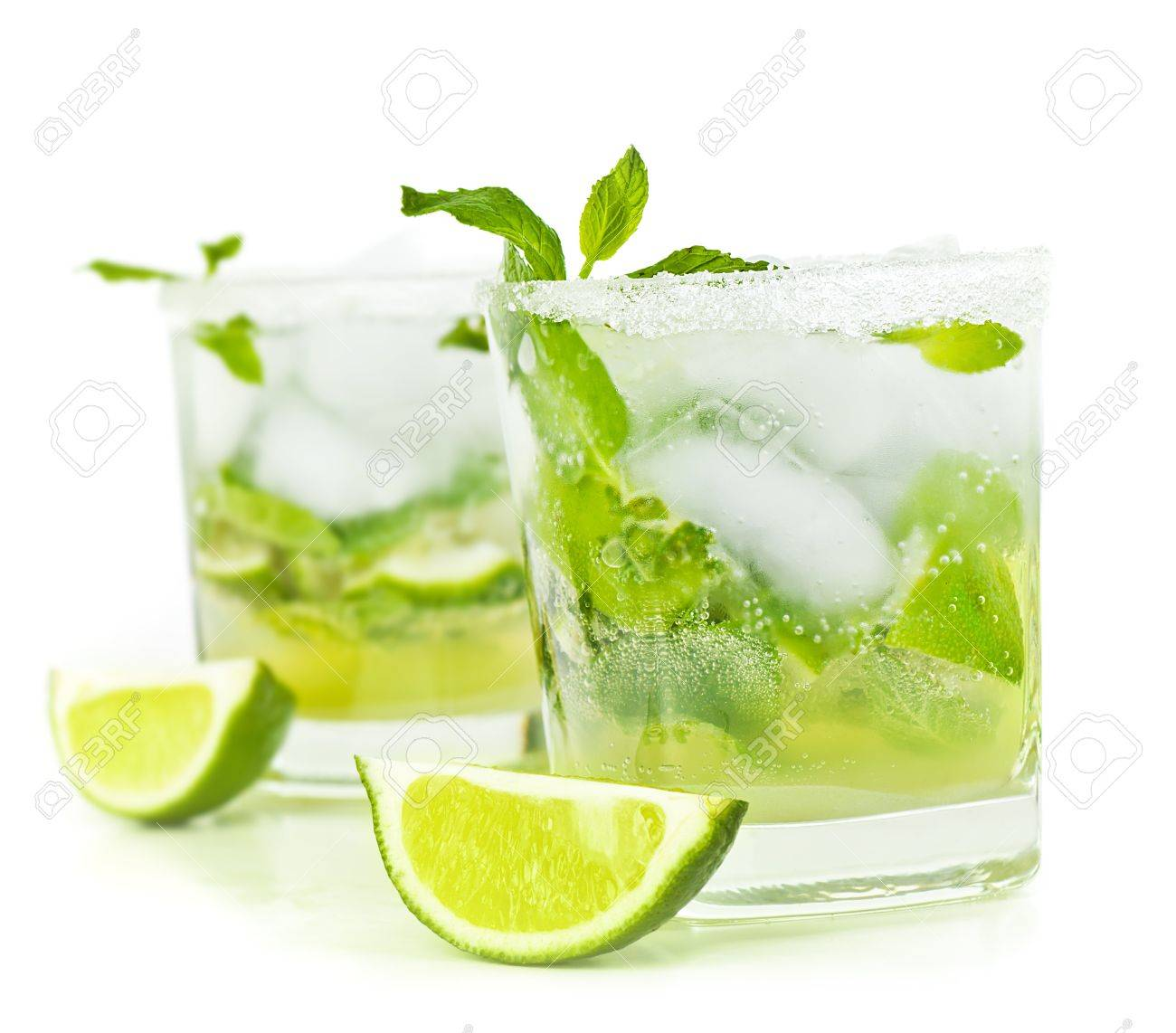 Cold mojito drink, glass of alcohol isolated over white background, fresh mint and lime fruit slice, food still life, party and holidays celebration Stock Photo - 13284858