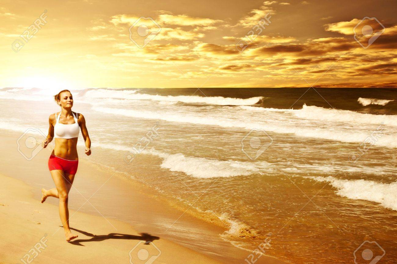 Healthy woman running on the beach, girl doing sport outdoor, happy female exercising, freedom, vacation, fitness and heath care concept with copy space over natural warm sunset background Stock Photo - 13525792