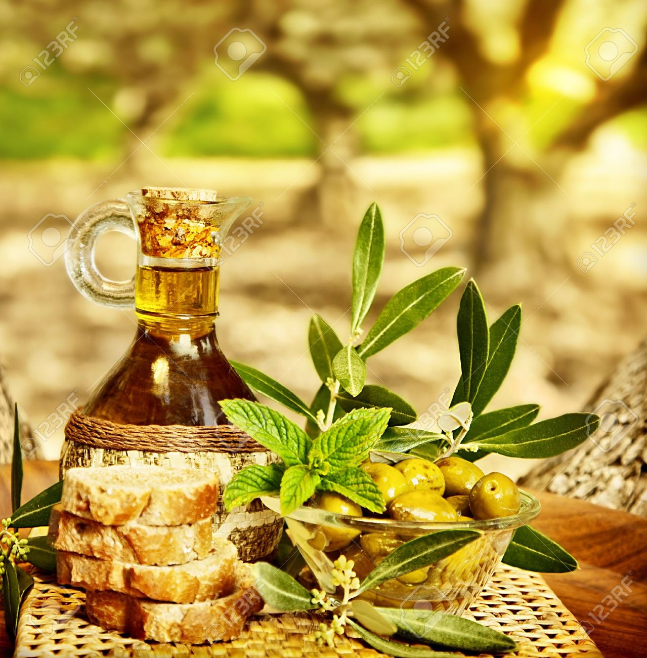 Olives still life, fresh food in garden of olive trees, farm land at countryside of Lebanon, homemade healthy olive oil and bread, harvest time Stock Photo - 13525751