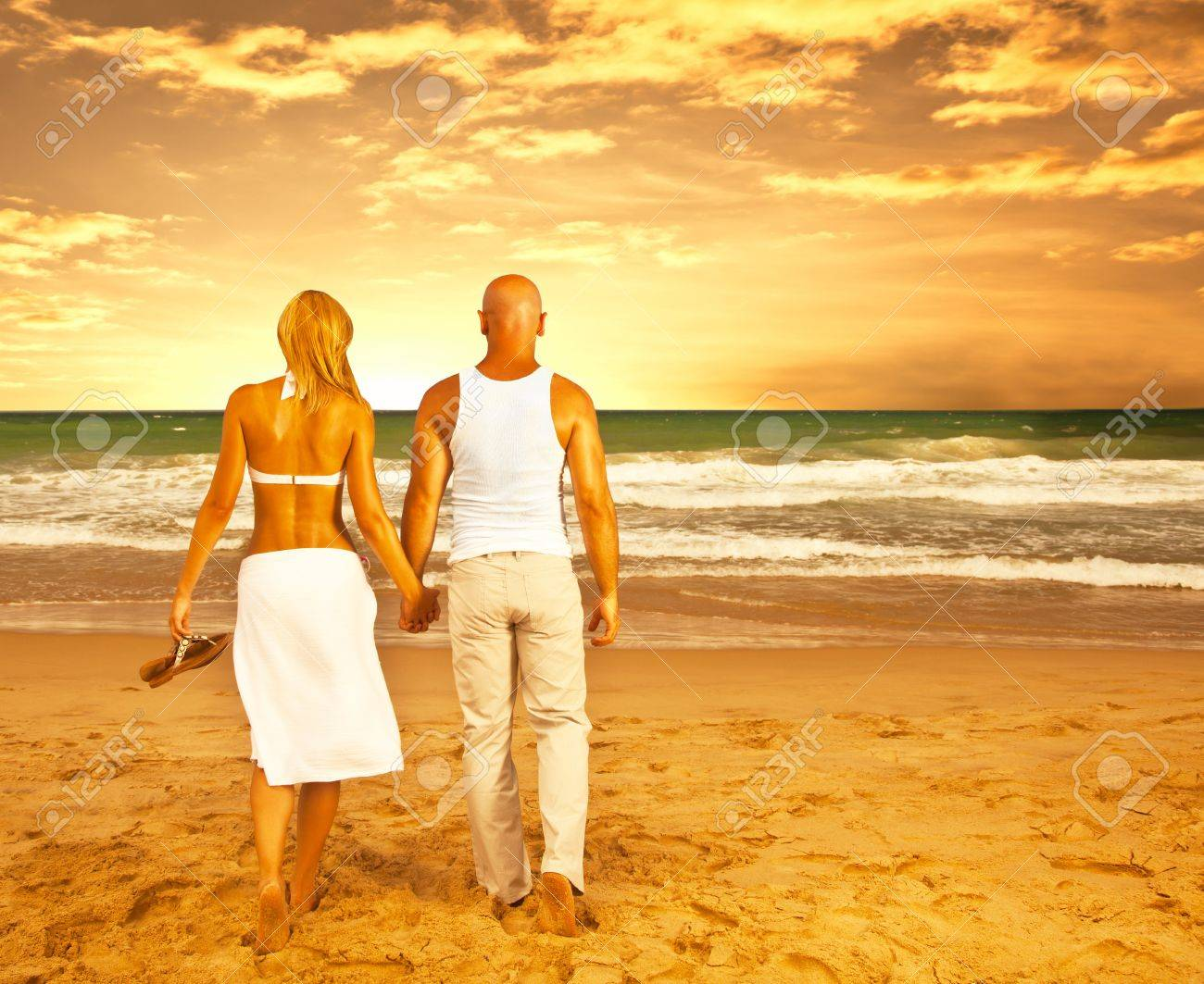 Happy couple on the beach, romantic travel, honeymoon vacation, summer holidays, people walking on sea sunset and holding hands, loving family relaxing outdoor, love concept Stock Photo - 13619013