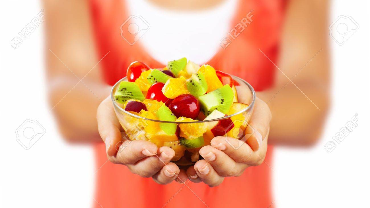 Healthy mix fruit salad, closeup on fresh summer dessert, woman holds lunch bowl, selective focus on female hands, eating girl shallow dof, body weight care, health and diet concept - 13791832