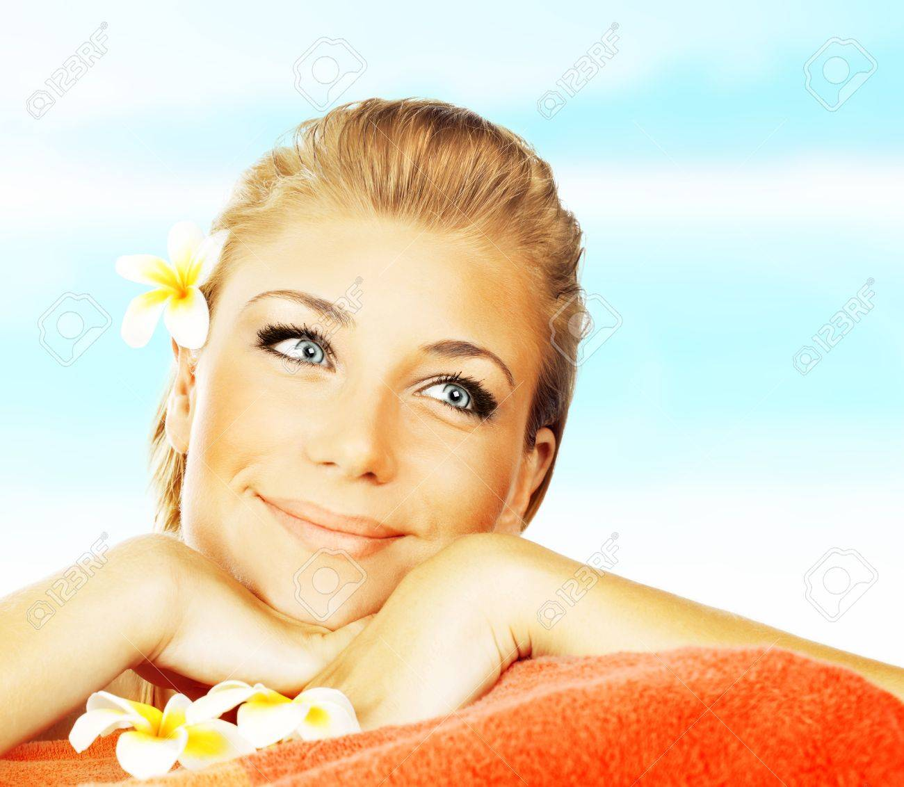 Beautiful woman  lying on massage bed at outdoor luxury spa salon, girl sunbathing on the pool, skin care treatment, young female enjoying sun, relaxing vacation at summer tropical beach resort Stock Photo - 14010560