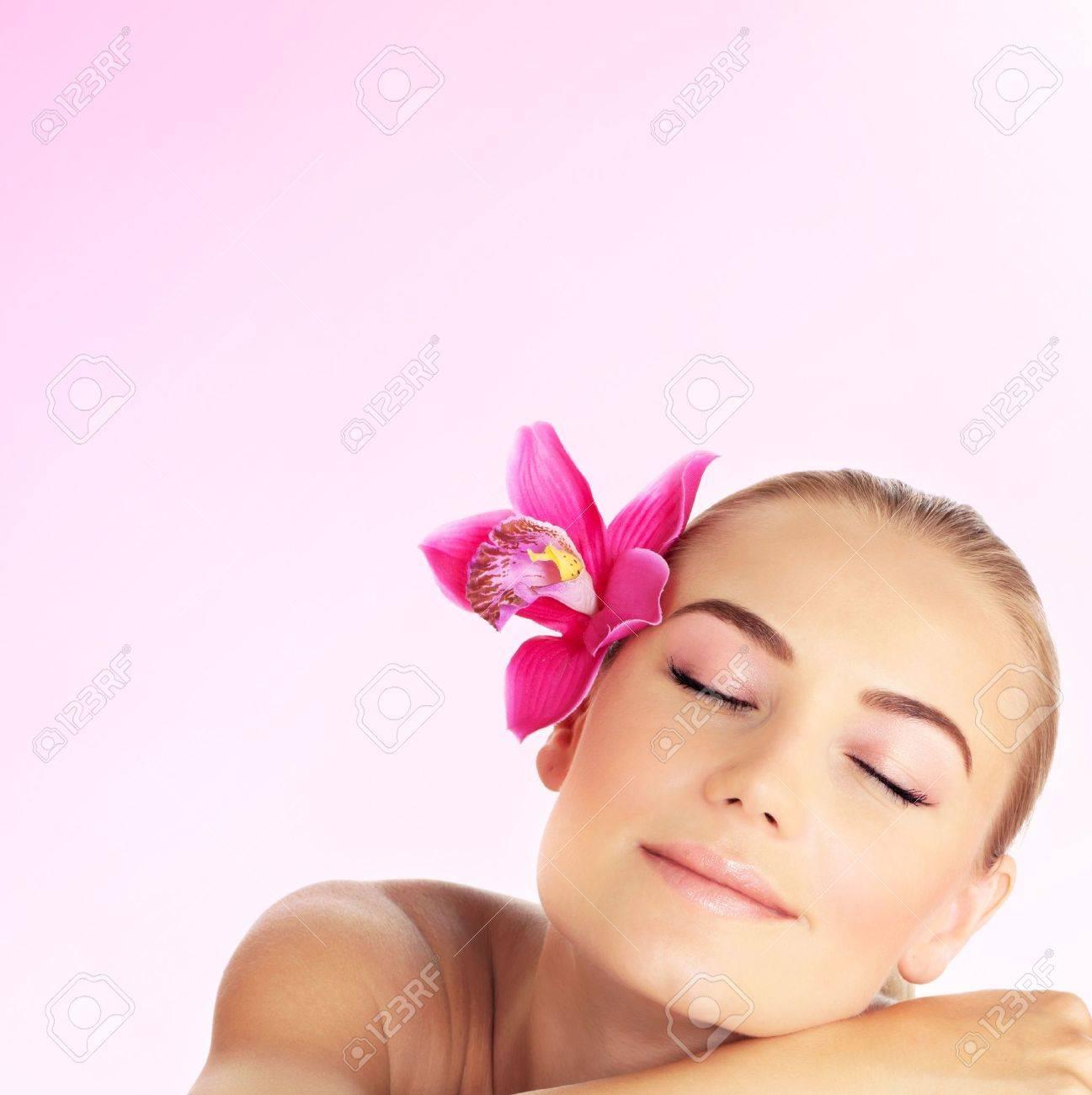 Young woman at spa salon, beautiful girl sleeping on massage..