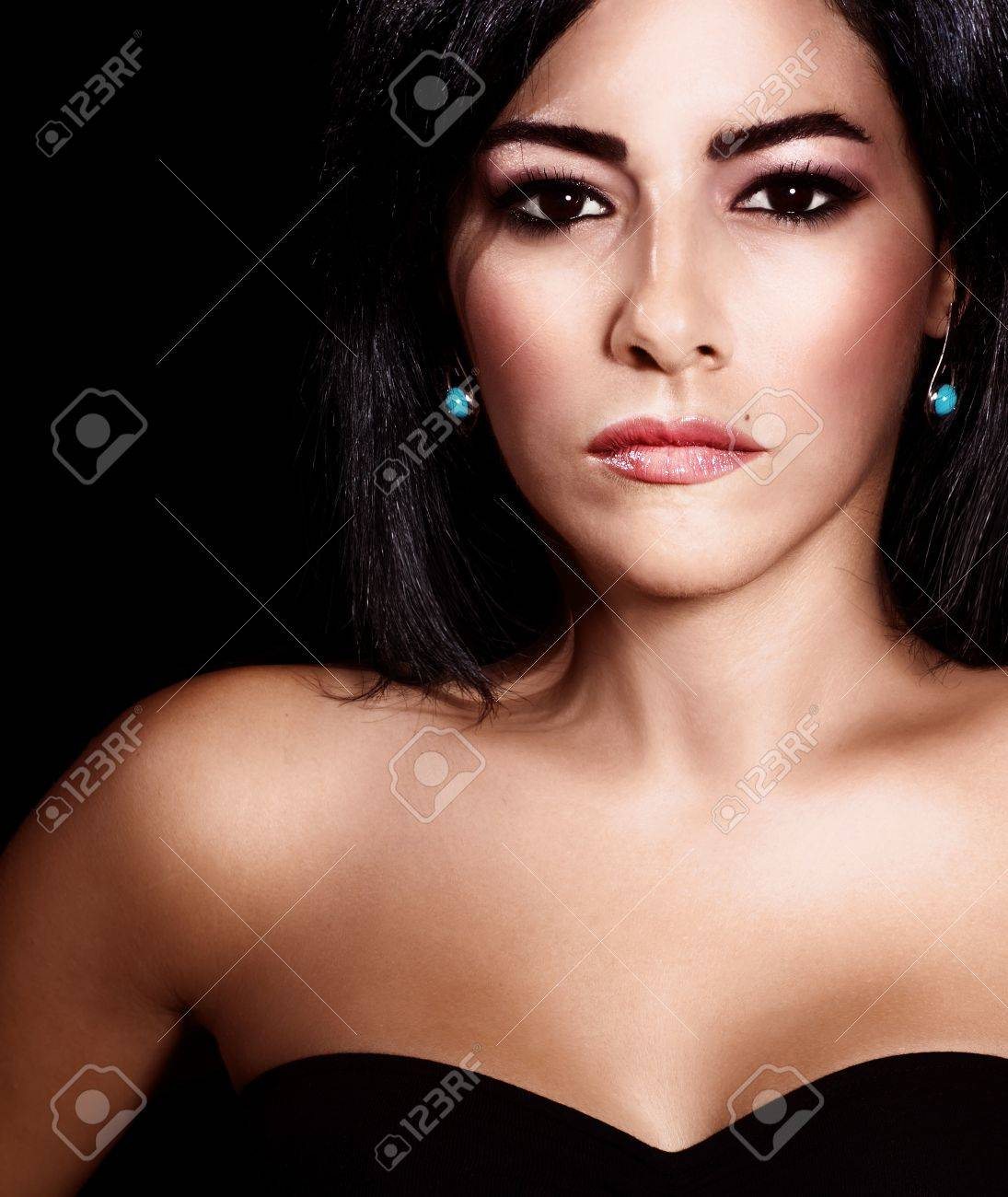Picture of beautiful attractive girl, closeup portrait of elegant arabic woman with dark hair isolated on black background, female with perfect tanned skin, luxury and beauty concept Stock Photo - 15238281