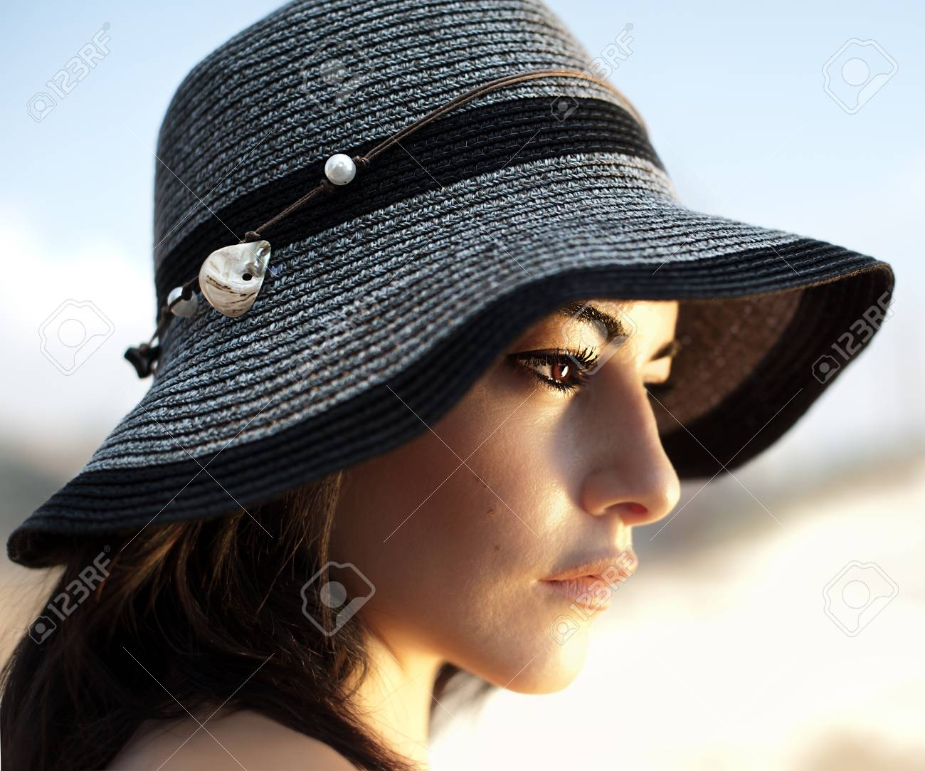 Picture Of Beautiful Woman In Stylish Black Hat 482dfa9bd2b