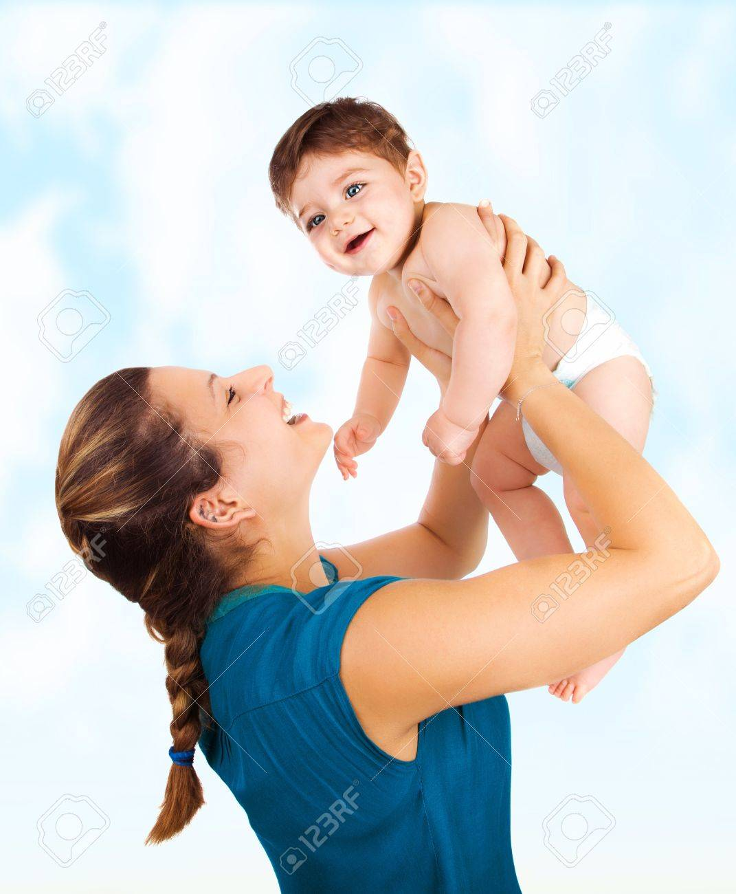 A young beautiful mother with cute baby boy stock photo 15776178