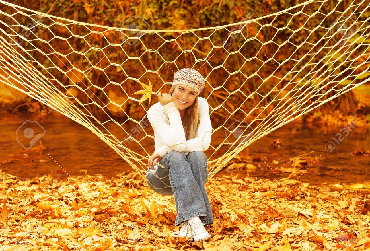 picture of attractive woman swinging in hammock on backyard