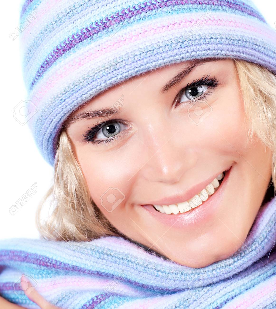 Happy girl in winter hat, beautiful young female wearing knitted warm wintertime clothing Stock Photo - 16086078