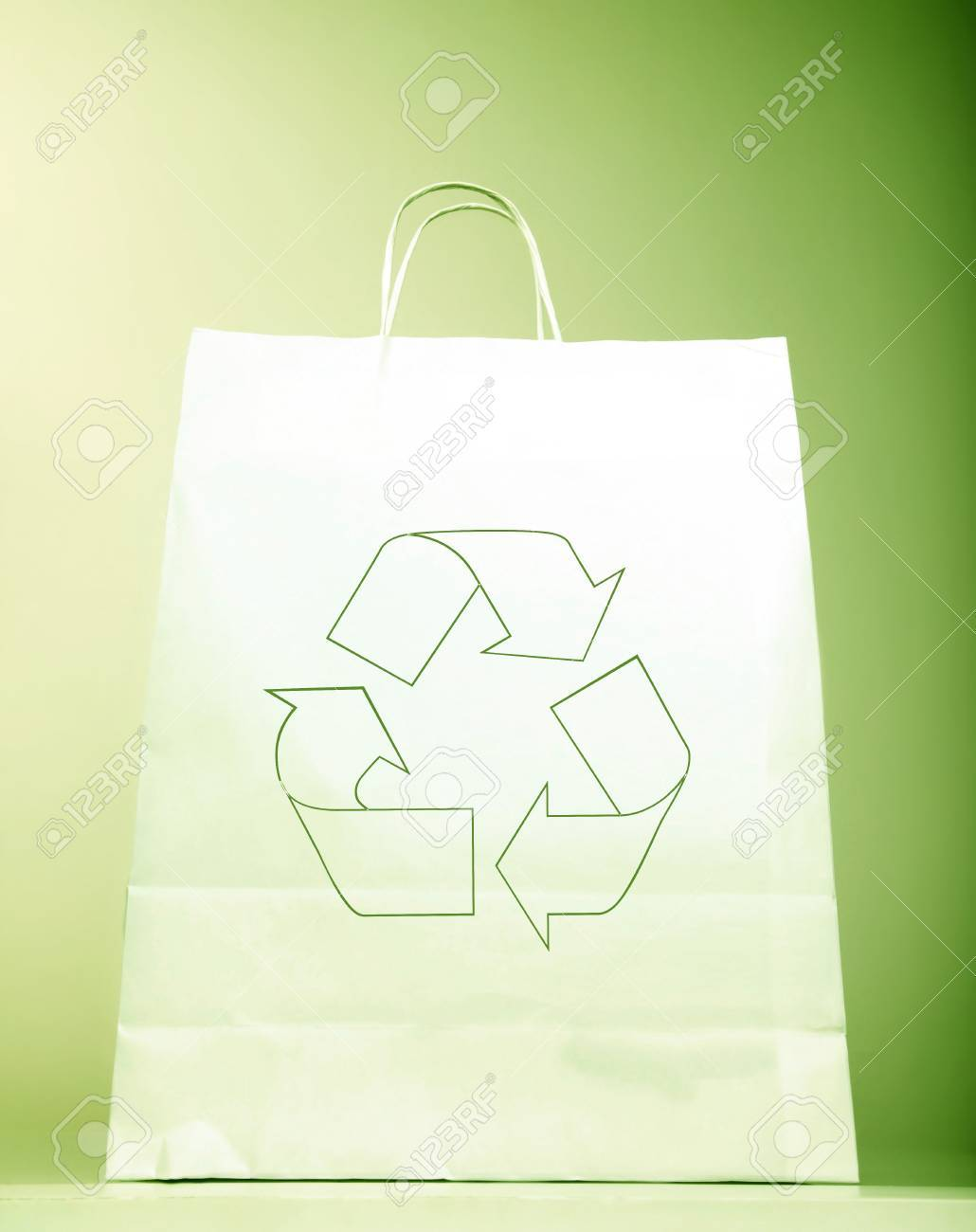 White paper bag with ecology symbol, present with recycle sign isolated on green background, recyclable shopping bag & Eco icon, concept idea to help to save planet  earth from pollution Stock Photo - 16158507