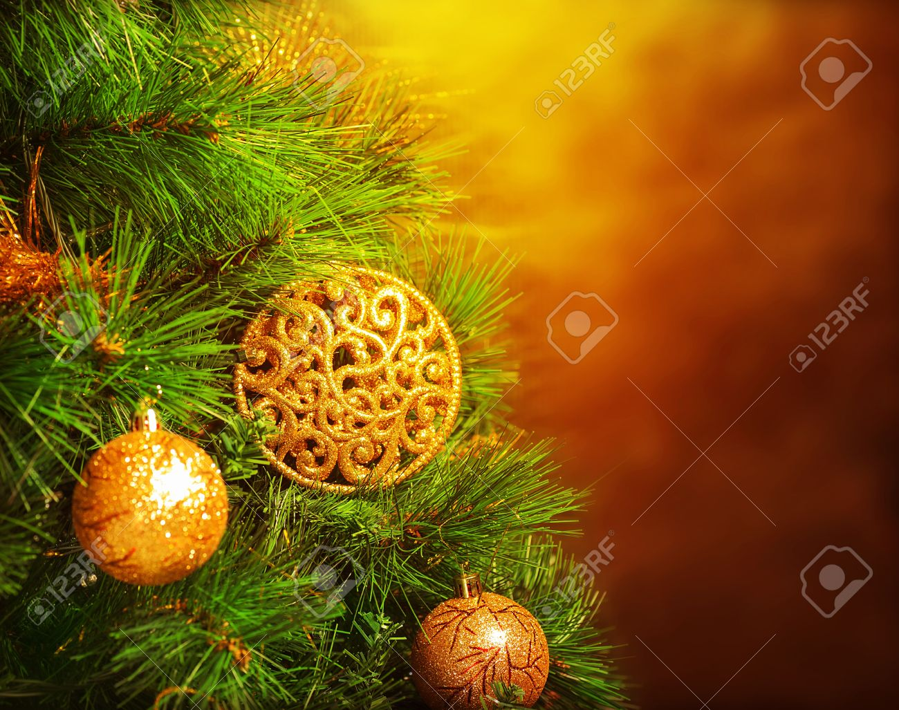 Photo of traditional Christmas tree isolated on brown grunge background, green fir decorated with golden bubbles toy, happy New Year greeting card, adorned pine tree at home, winter holidays - 16510563
