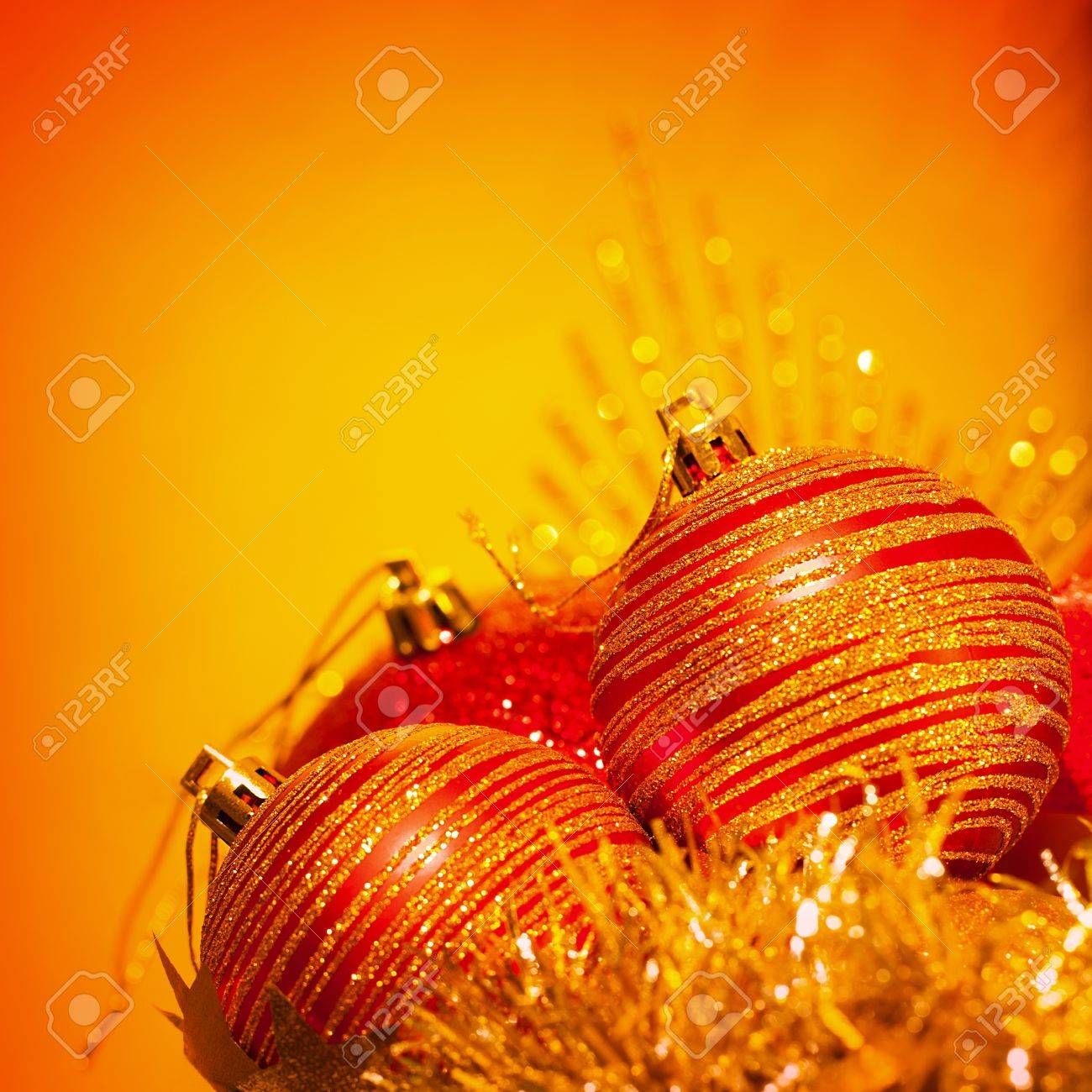 image of red christmas bubbles border festive decorations isolated on orange background golden holiday