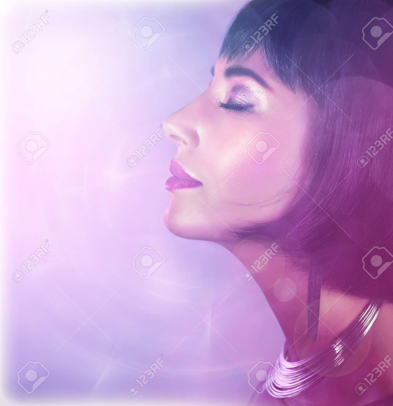 Picture of attractive girl with perfect makeup isolated on purple background Stock Photo - 16632088