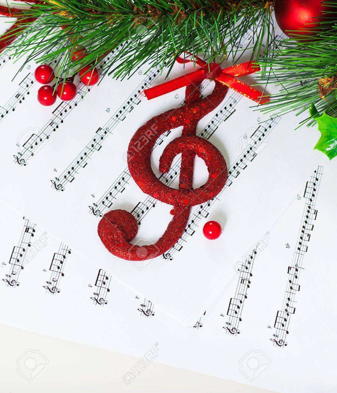 Image of red festive treble clef on the notes paper Stock Photo - 16632187