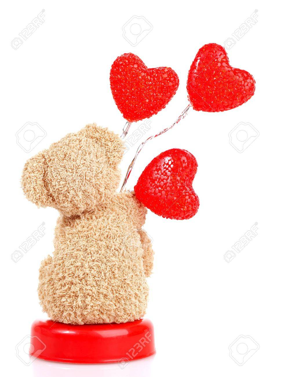 dd412f4f Photo of teddy bear with red heart-shaped balloon isolated on..