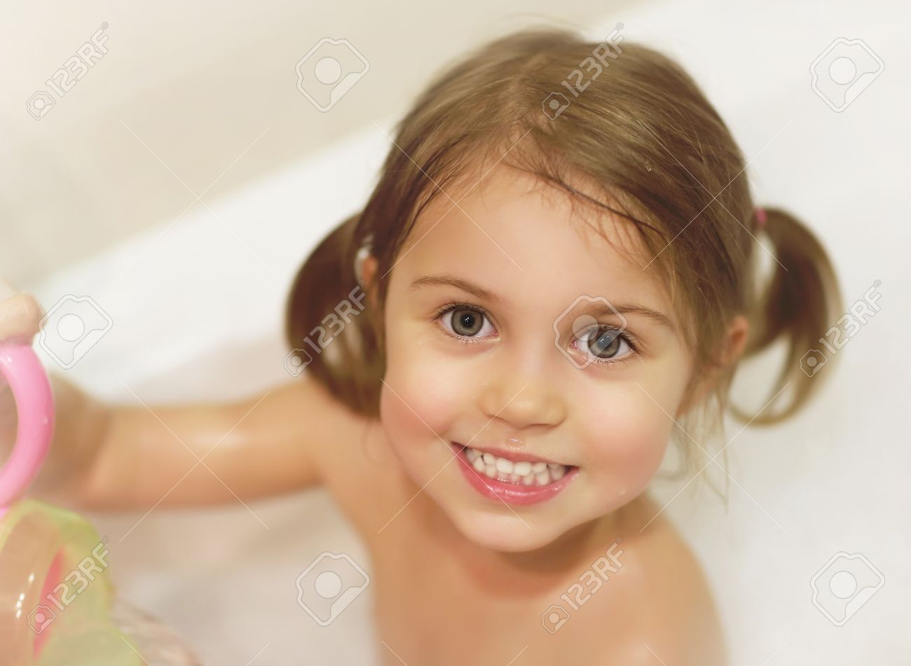 photo of cute baby girl taking bath happy childhood child s