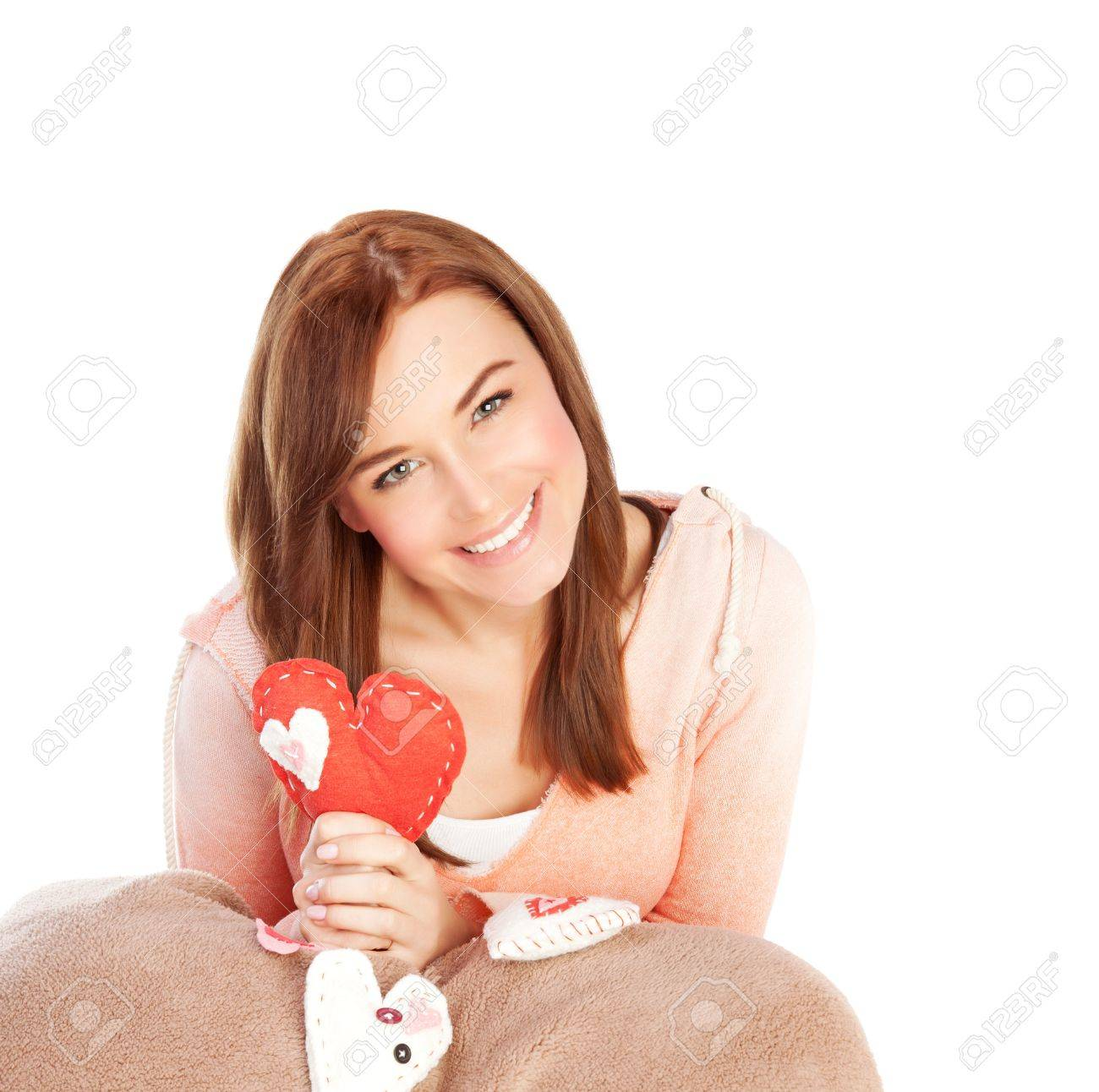 Picture of cute young lady with red handmade heart-shaped soft toy isolated on white background, Valentine day, romantic gift, lovely female, 14 of february, love and happiness concept Stock Photo - 17641580