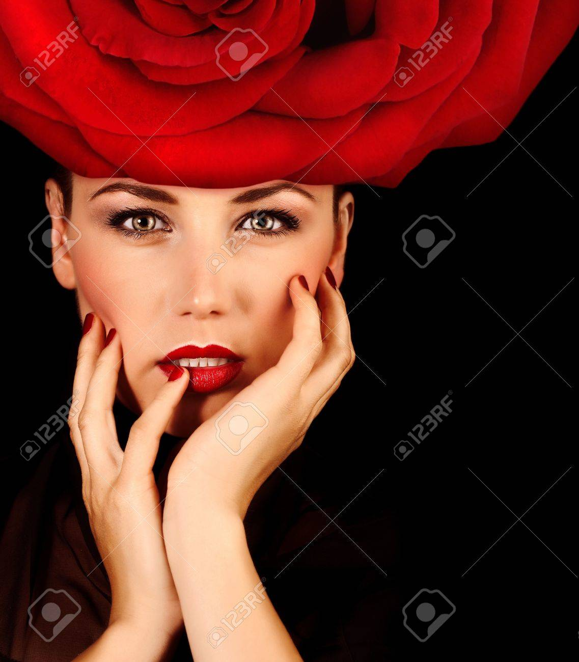 Photo of beautiful sexy woman with red rose hat on the head isolated on  black background bb6912ca924e