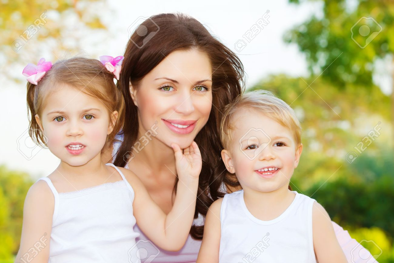 photo of beautiful woman with two cute kids, closeup portrait