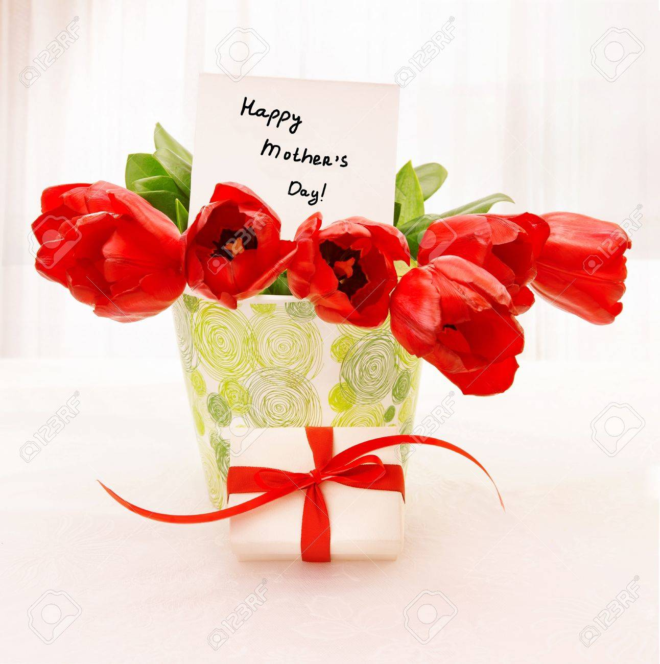 Picture Of Fresh Red Tulip Flowers In Beautiful Vase With Paper