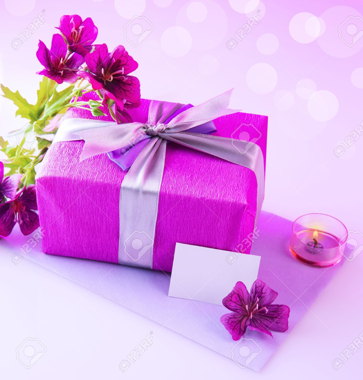 Photo Of Pink Giftbox With Silk Bow Fresh Purple Flowers Candle