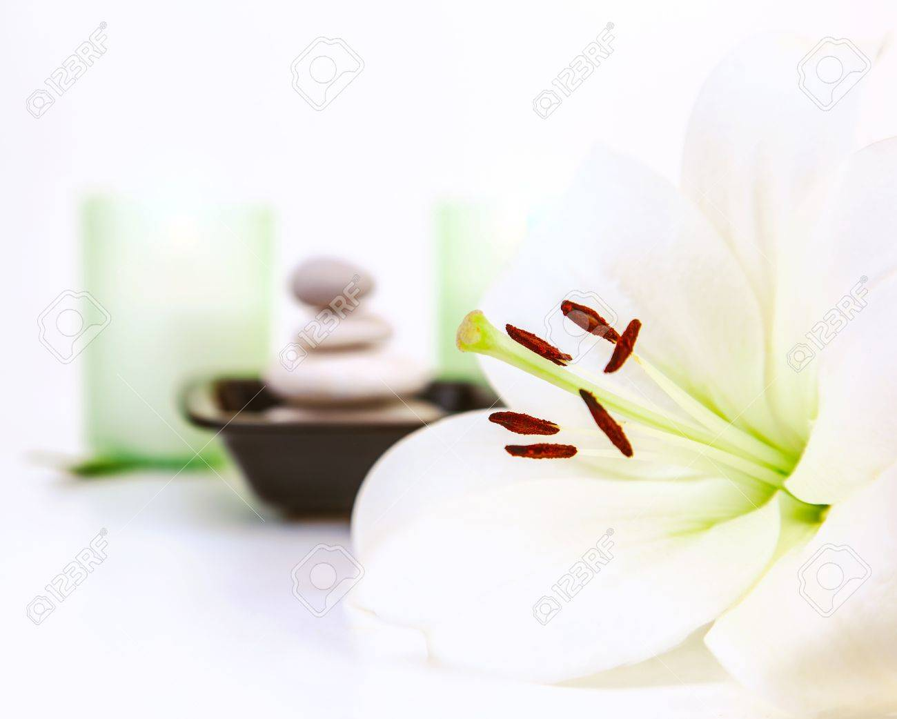Photo Of Beautiful White Lily Flower Pebble Stones Two Candles