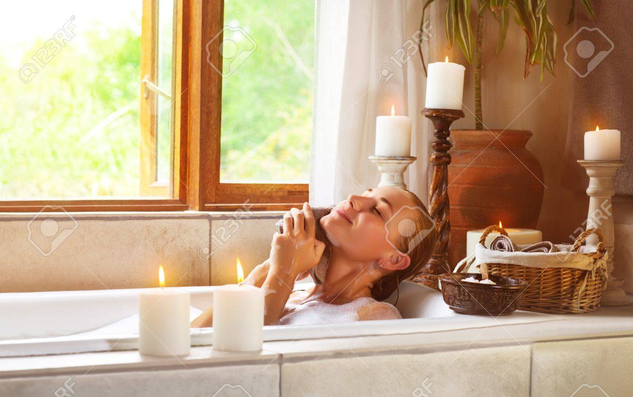 Image of nice female taking bath in gorgeous bathroom with aroma candles  alternative treatment  Image. How To Bath In Bathroom