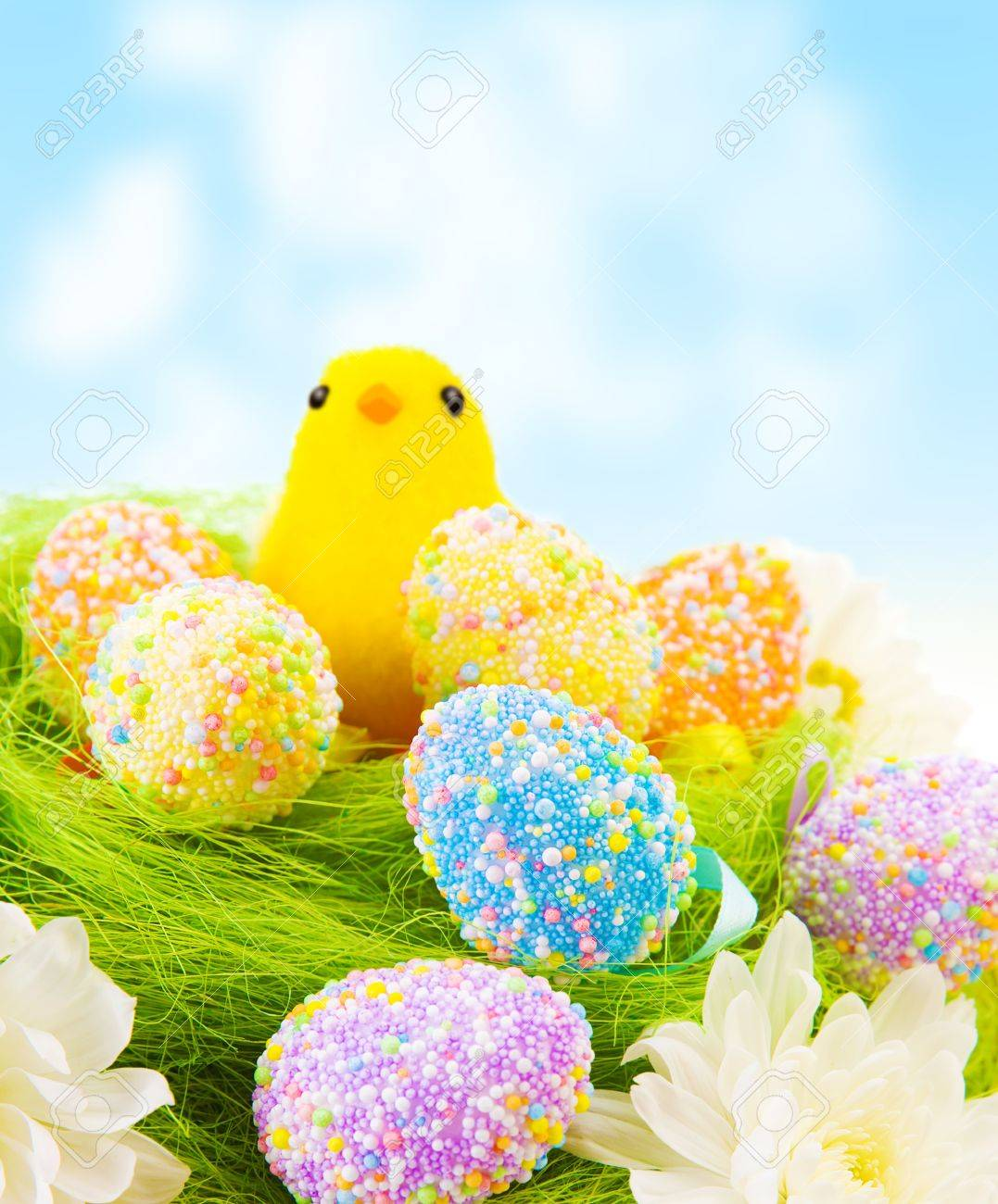 Easter decoration outdoor - Cute Small Yellow Chick Toy With Colorful Eggs In The Nest Outdoor Traditional Easter Decoration