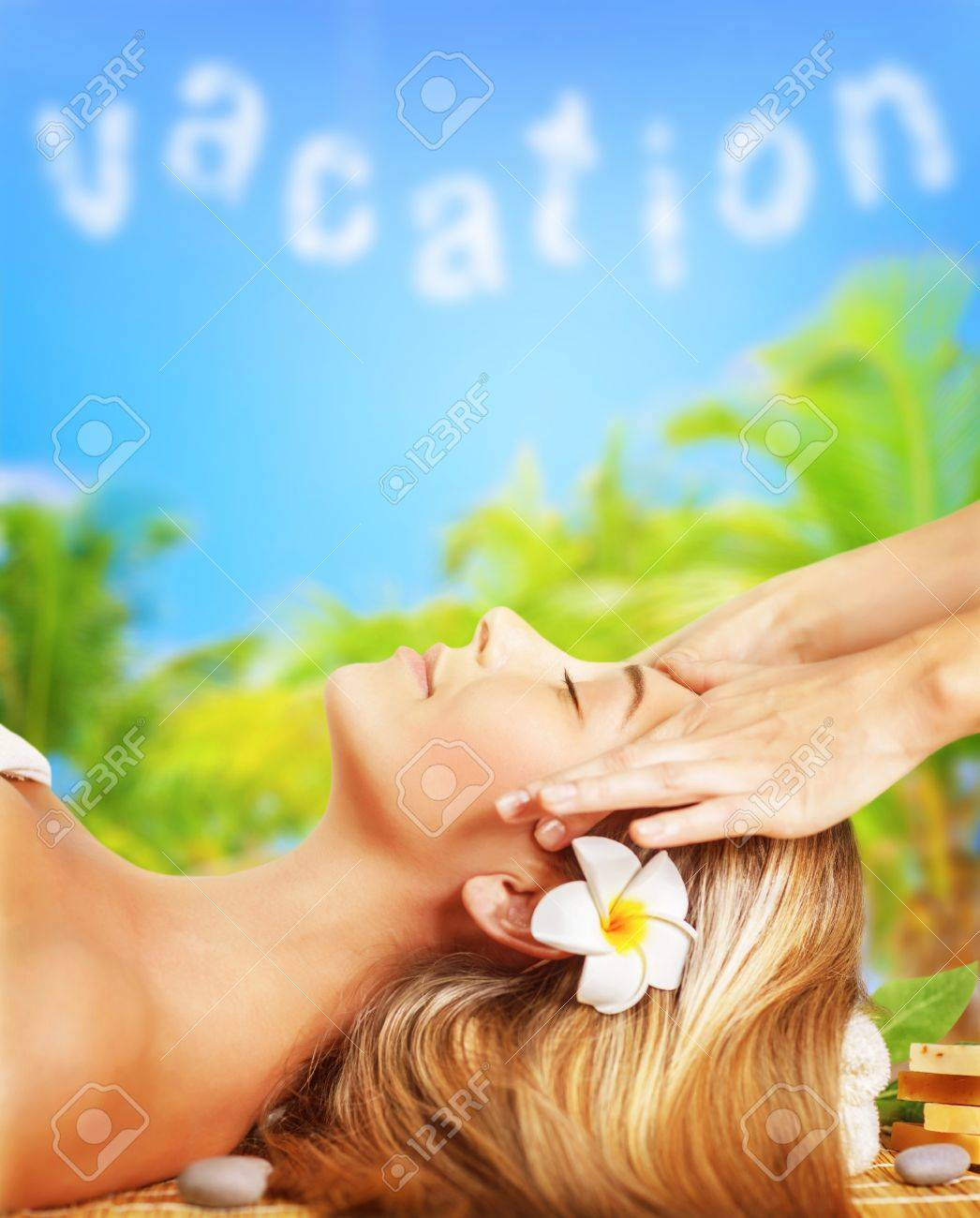 Closeup on attractive woman lying down on massage table outdoors Stock Photo - 20141301