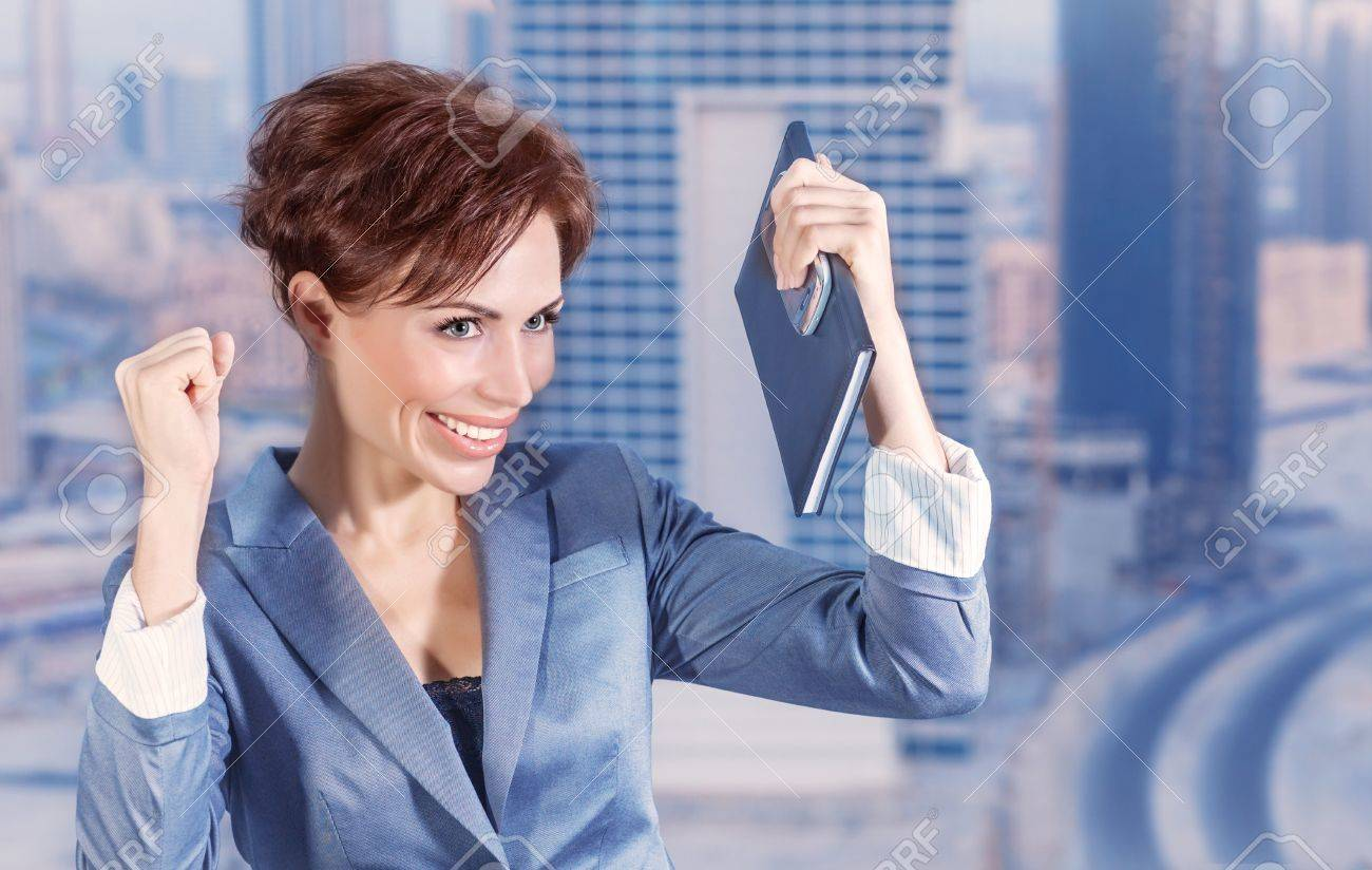 Closeup portrait of attractive happy business woman on city background, successful career, done deal, executive manager, business and success concept Stock Photo - 21512218