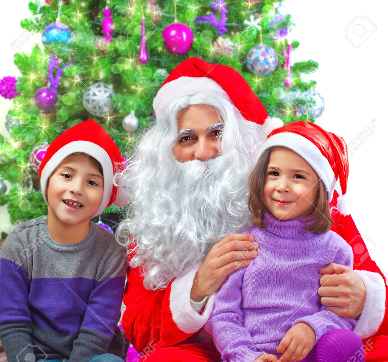 Portrait of two adorable kids sitting with Santa Claus at home near Christmas tree, winter holidays, New Year party, festive decorations, fun concept Stock Photo - 22483564