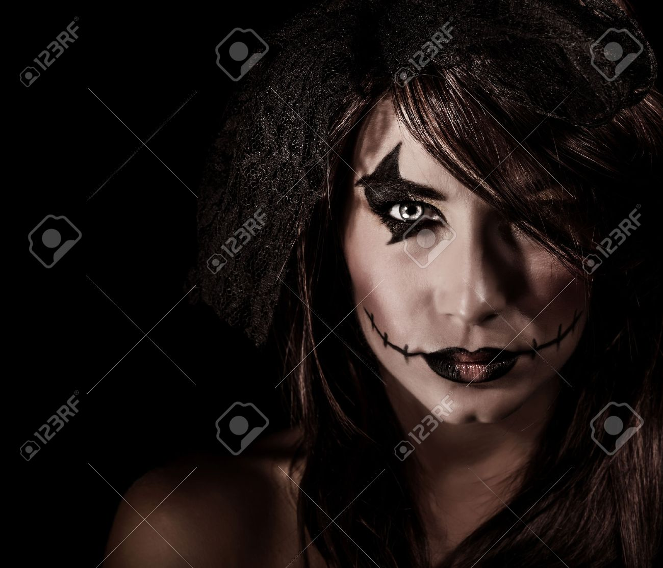 terrifying witch portrait isolated on black background attractive woman with scary makeup halloween party