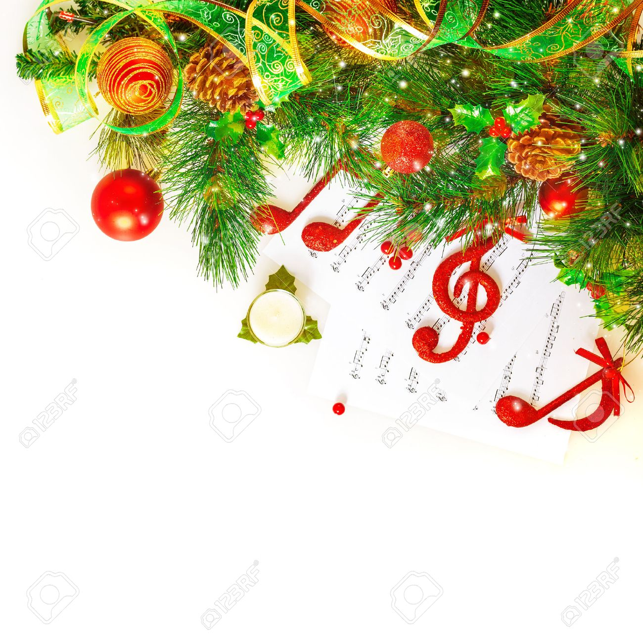 Festive musical still life, red treble clef and notes decorated fresh green fir tree branch isolated on white background, Christmas holidays concept Stock Photo - 23569465