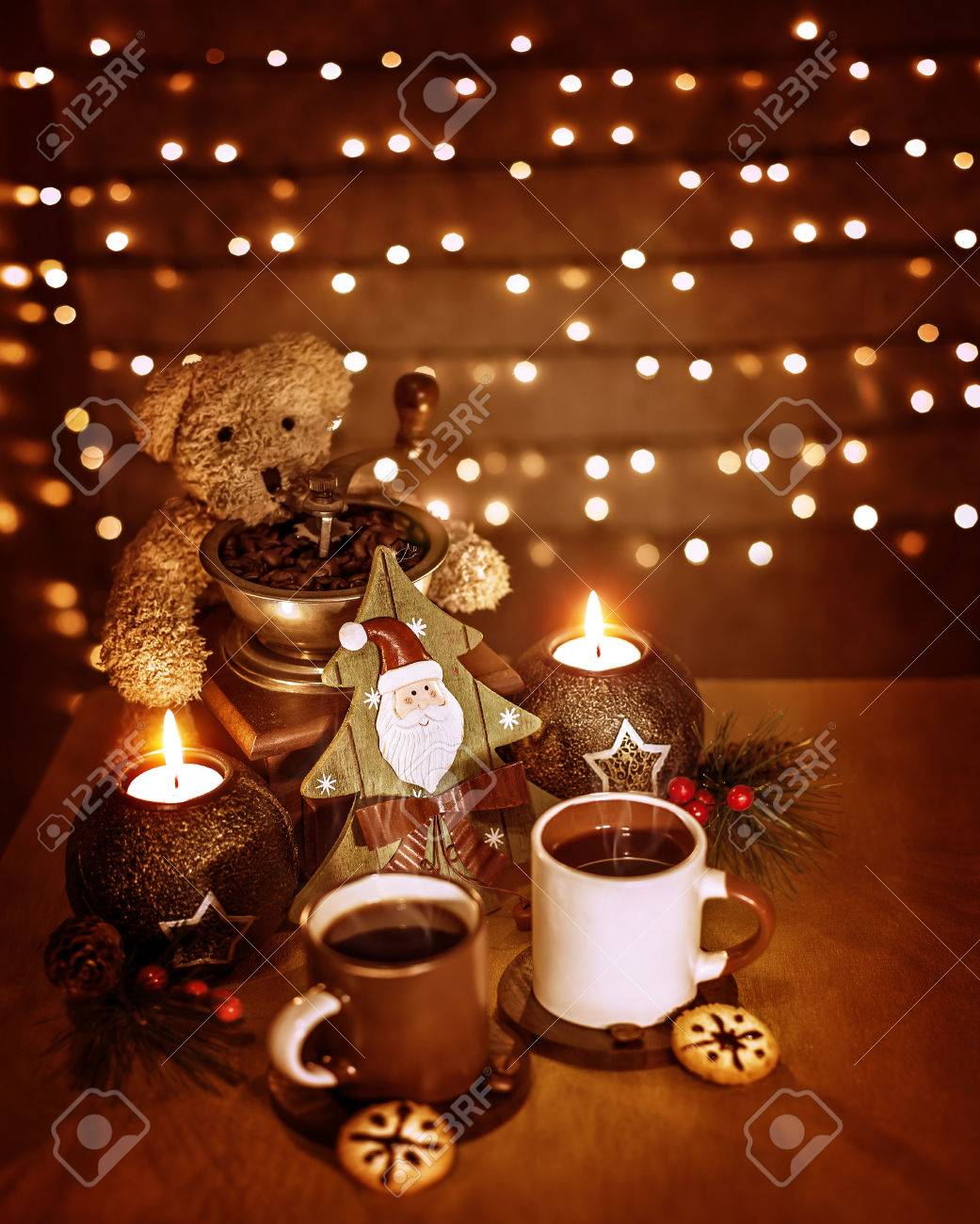 Elegant Christmastime Decoration, Beautiful Festive Still Life On The Table On  Glowing Wall Background, Cups