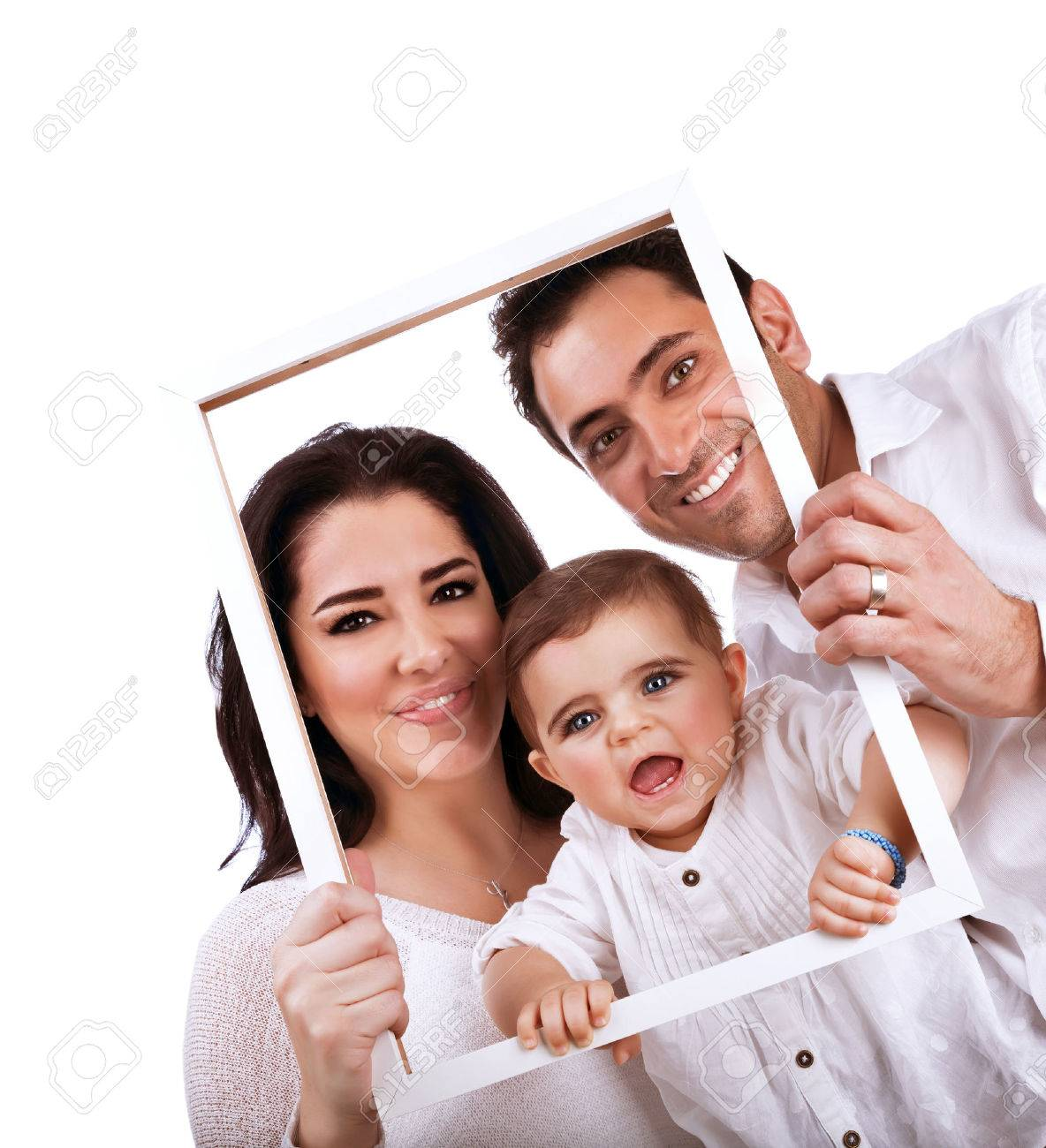 Happy family portrait isolated on white background holding in hands frame nice picture of