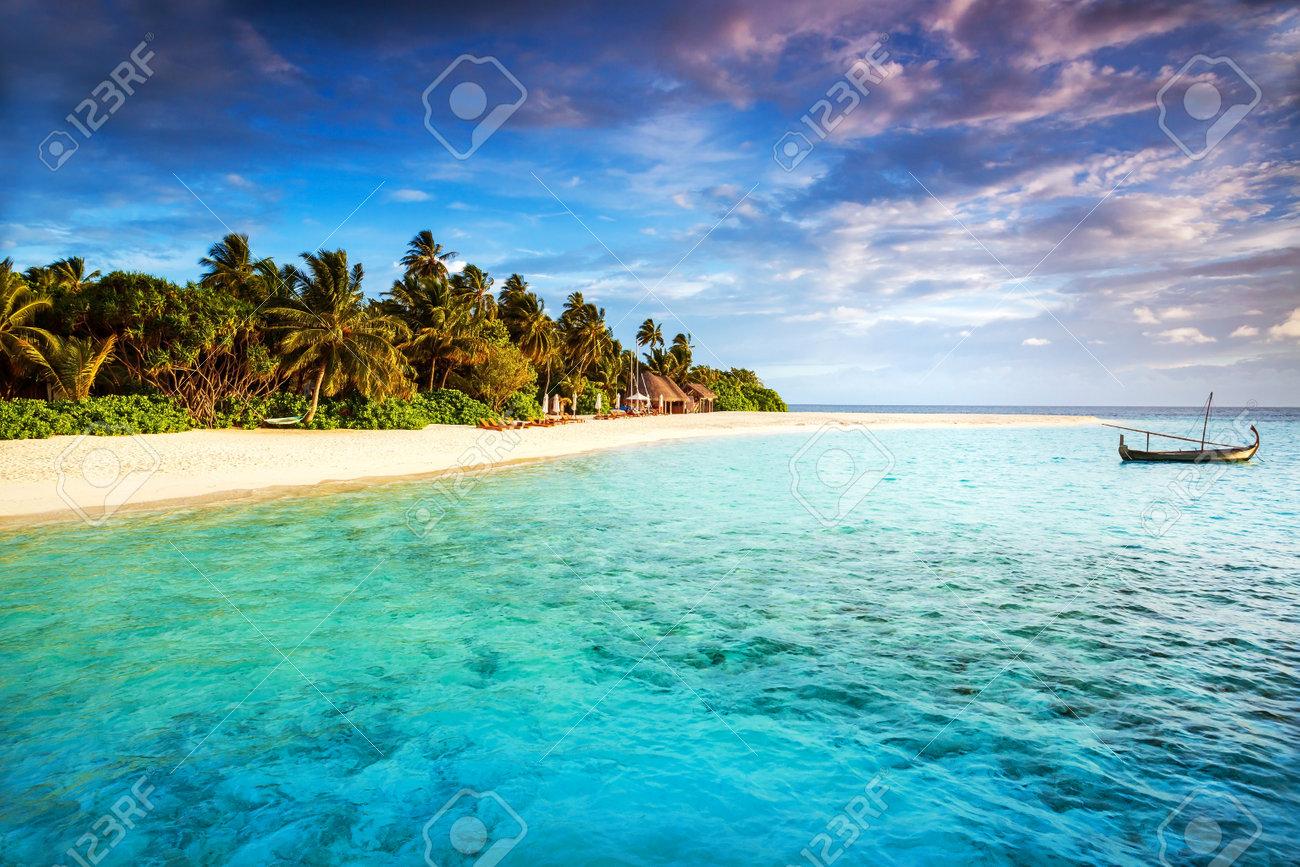 Beautiful Tropical Island Summer Adventure Fishing Boat In Transparent Blue Ocean Fresh Green