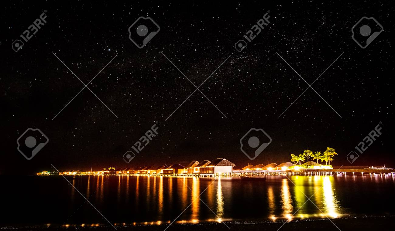 Night On Tropical Resort Many Little Beach Houses Glowing Bright