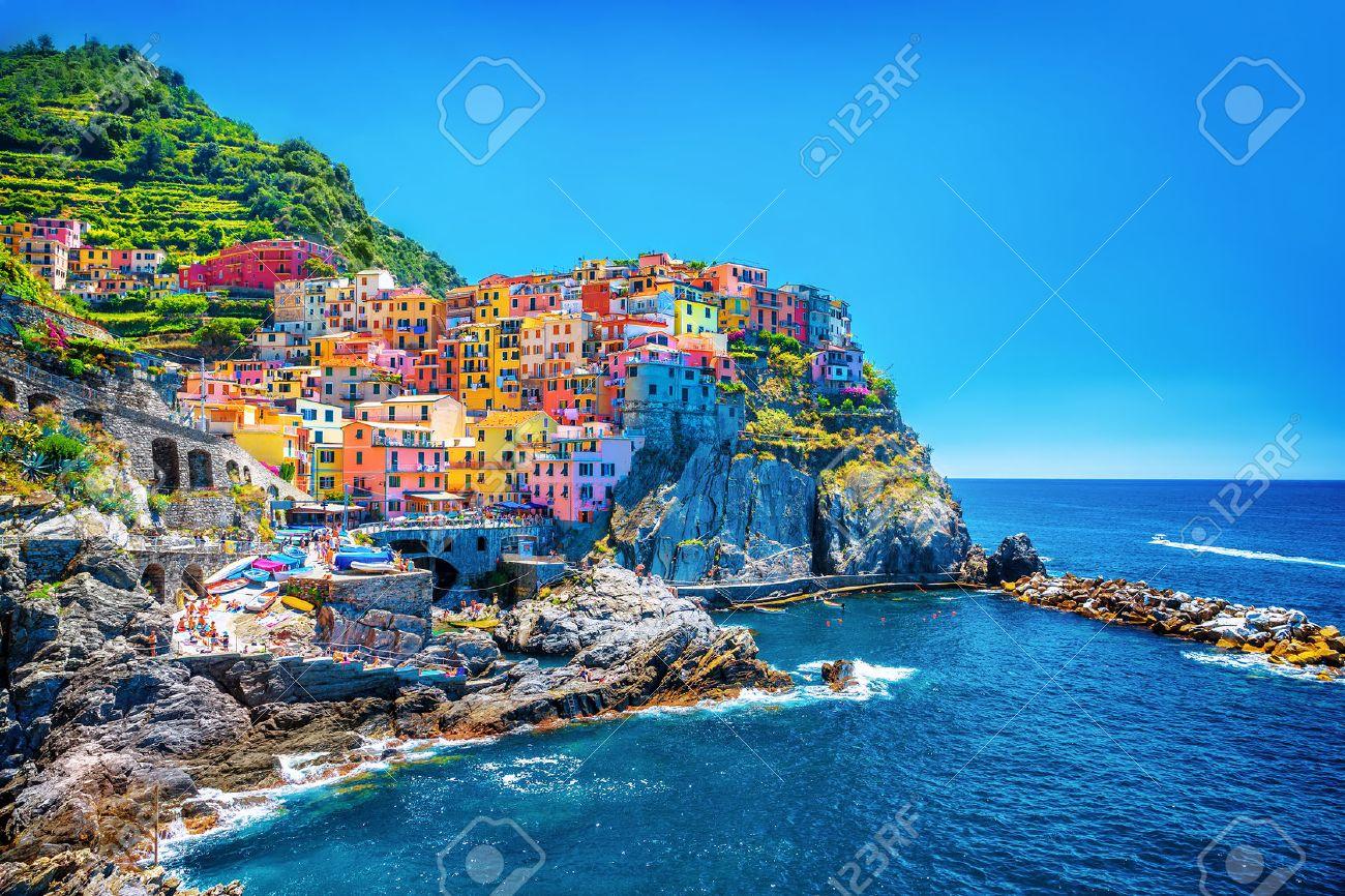Beautiful colorful cityscape on the mountains over Mediterranean sea, Europe, Cinque Terre, traditional Italian architecture - 30425890
