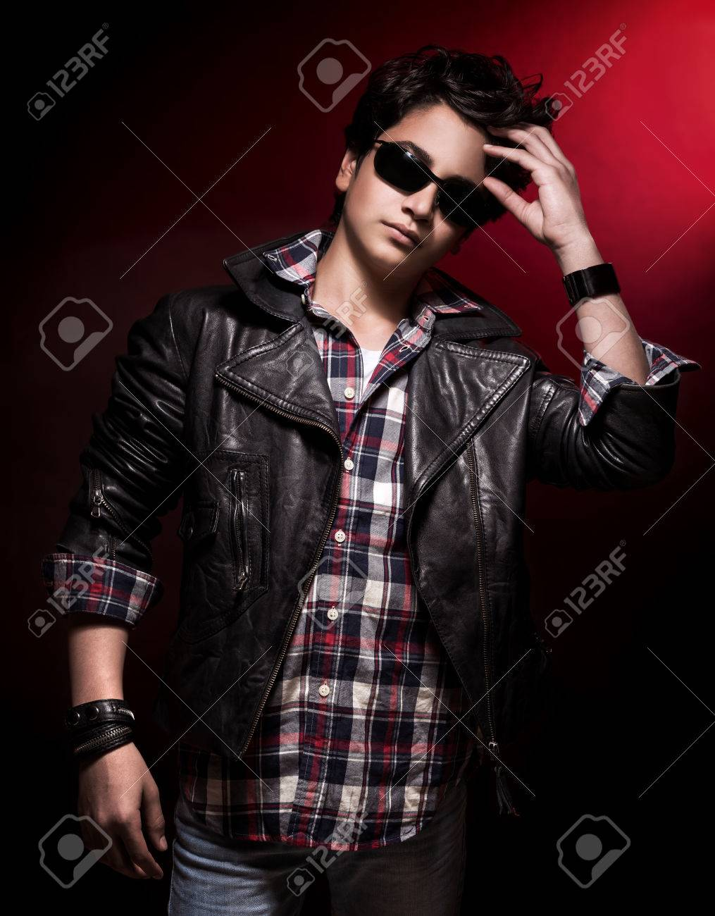 Handsome Teen Boy Wearing Stylish Sunglasses And Leather Jacket