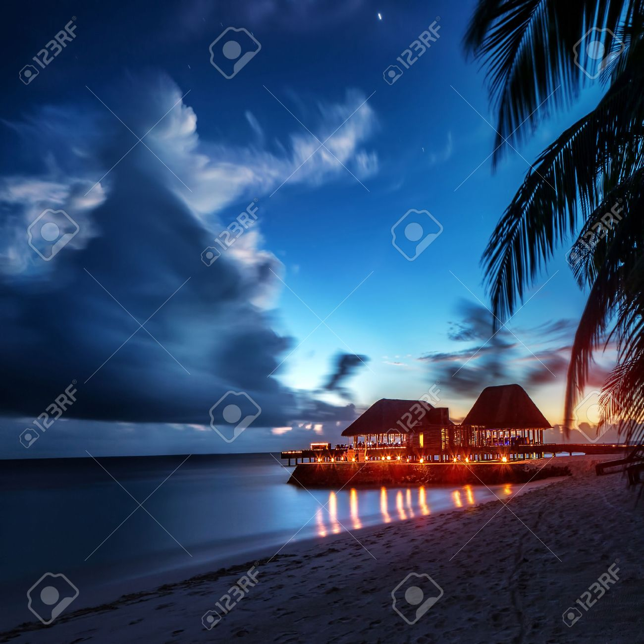 Paradise Beach At Night Glowing Light In The Restaurant Over Water Romantic Place For