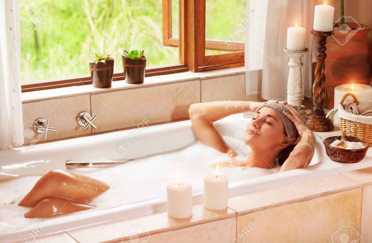 Woman Relaxing At Spa Resort Lying Down In The Bath With Closed Eyes And Make A Compress Pleasure And Healthy Lifestyle Stock Photo Picture And Royalty Free Image Image 46091065