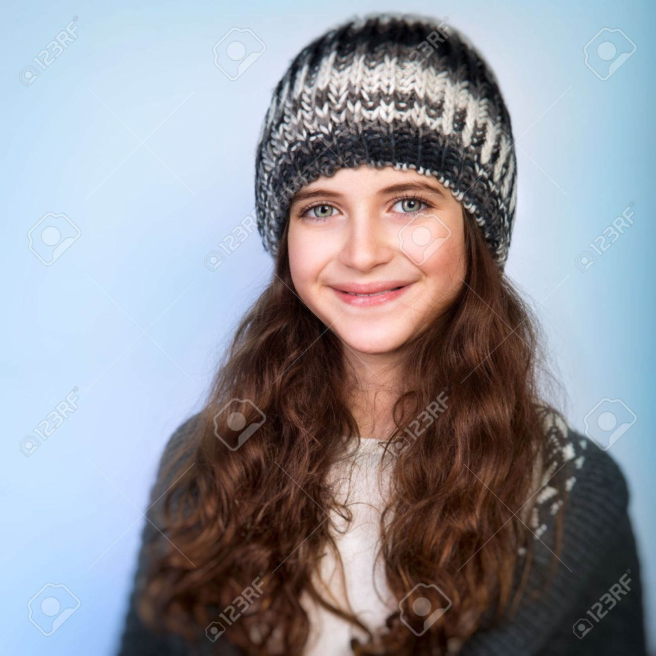 teen girl: Portrait of cute teen girl wearing stylish knitted hat and  sweater isolated on