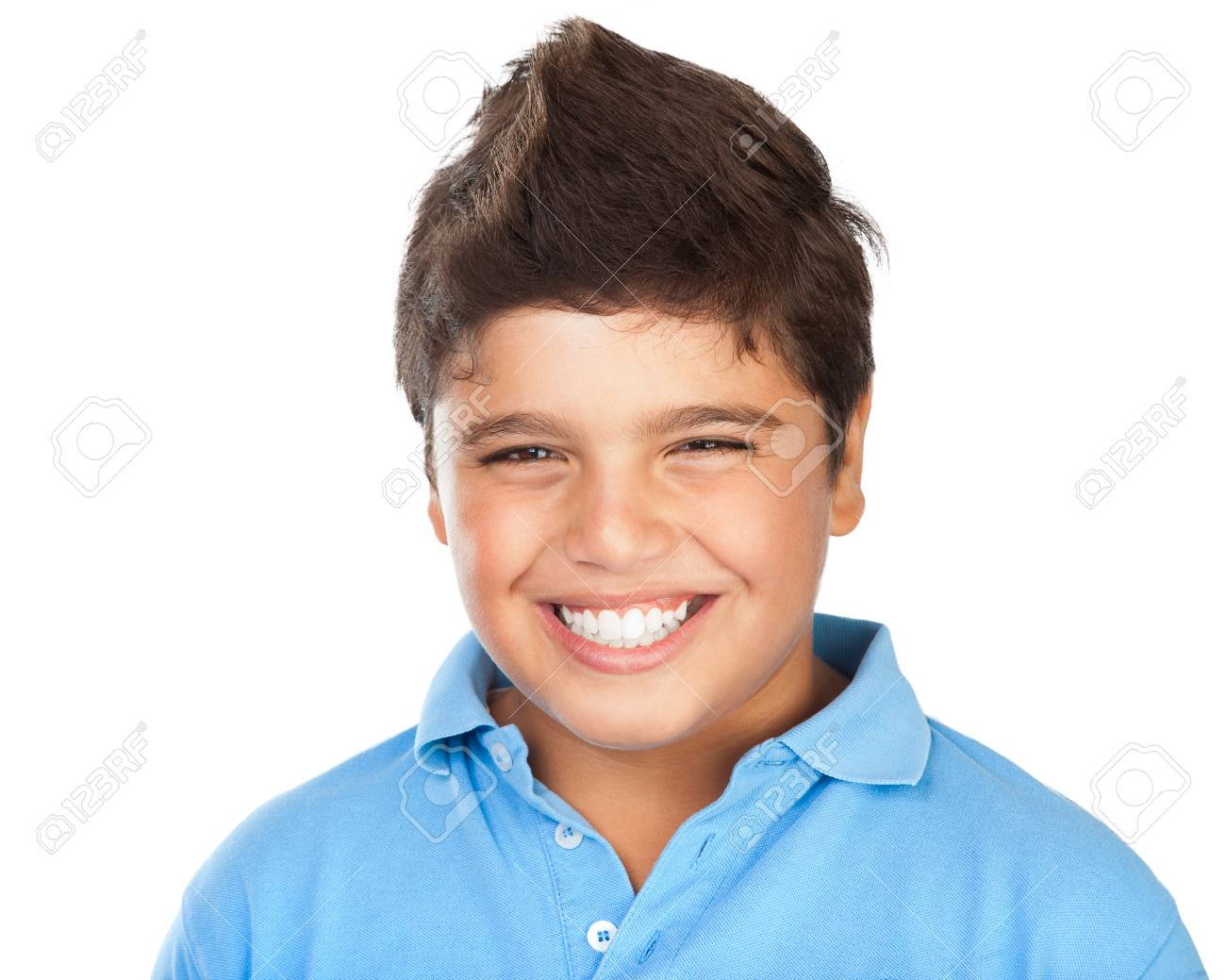 Portrait of a cheerful smiling boy isolated on white background, teenage model posing in the studio, happy facial expression, perfect toothy smile - 52523423