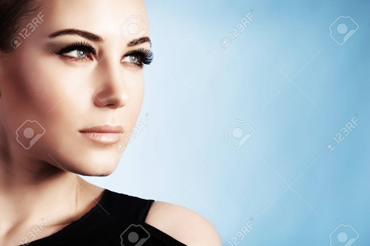 Closeup portrait of a beautiful woman isolated on blue background, gorgeous girl with perfect makeup, good looking model - 71442309