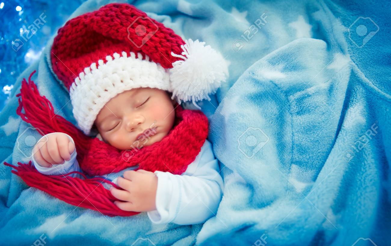 Portrait of a cute little baby boy wearing festive Santa hat and sleeping  at home 6a5e00c244bc