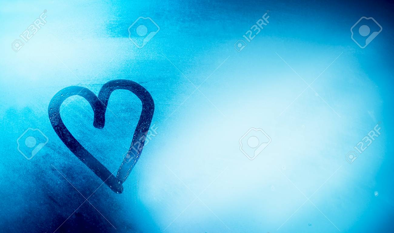 Love is in the air, heart shaped drawing on the misted-up window, abstract blue background, romantic winter holidays concept, happy Valentines day - 94607481