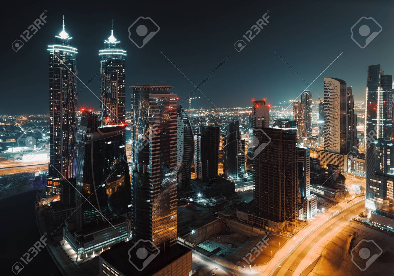 Beautiful Cityscape of a Modern Futuristic Buildings and Towers in the Lights of a Night City. Beauty of Luxury Life of Emirates. Dubai. United Arab Emirates. - 159395976