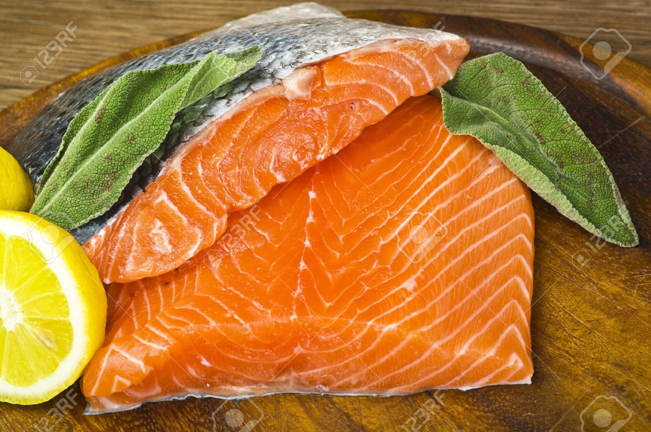 salmon fillet close up on wood table Stock Photo - 10929180